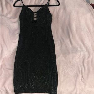 Form fitting black and silver midi dress